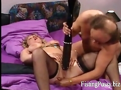 Hot brunette milf (FistingPussy.biz) gets a brutal fisting in all directions her greedy pussy