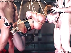 Brunette double penetrated by means of fetish threesome