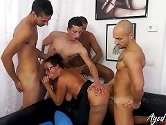 Aged brunette adores gangbang and sample penetration